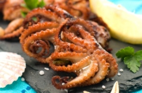 Grilled octopus with lemon, selective focus